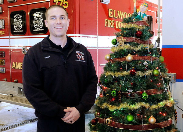 Don Knight | The Herald Bulletin<br /> Elwood firefighter Ryan Moore shared his memories of Christmas growing up in the 90s in Peru.