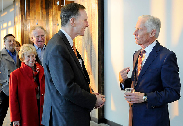Don Knight | The Herald Bulletin<br /> Chuck Staley, right, greets Anderson University President John Pistole as he arrives at his retirement reception at Flagship East on Wednesday. Chuck and his wife Lynn are moving to the St. Louis area to spend more time with family.