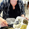 John P. Cleary | The Herald Bulletin<br /> Volunteer Stephanie Hilton fills another to-go container during the St. Mary's Catholic Church annual Christmas day dinner in Alexandria.