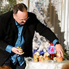 Don Knight | The Herald Bulletin<br /> Clint Dunn sets up a nesting doll nativity while giving decorating advice during the Christmas Tea at Gaither Studios on Saturday.