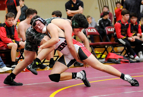 Don Knight   The Herald Bulletin<br /> Alexandria's Mikey Smith wresltes Pendleton Heights Jacob Brown in the 170 pound bout as the Tigers hosted the Arabians on Wednesday.