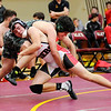 Don Knight | The Herald Bulletin<br /> Alexandria's Mikey Smith wresltes Pendleton Heights Jacob Brown in the 170 pound bout as the Tigers hosted the Arabians on Wednesday.