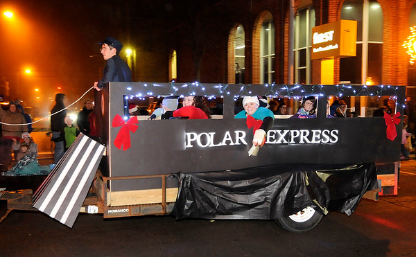 Don Knight | The Herald Bulletin<br /> Alexandria Family Practice decorated their float as the Polar Express for the Alexandria Christmas Parade on Friday.