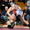 Don Knight | The Herald Bulletin<br /> Pendleton Heights' Derek Sikorski wrestles Alexandria's Max Naselroad in the 138 pound bout on Wednesday.