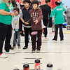 Don Knight | The Herald Bulletin<br /> Sergio Rivera, 11, tosses a ring to win a two liter pop during the City Wide Toy Giveaway at the UAW on Saturday.