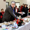 John P. Cleary | The Herald Bulletin<br /> Soroptimist International of Anderson had their annual Holiday Celebrity Cookie Walk as part of Anderson downtown Winterfest celebration Friday. Here Soroptimist member Julie Morse looks for more space along the display table for more cookies.