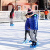 Don Knight | The Herald Bulletin<br /> Isaac and Cana Fair ice skate on the synthetic ice rink at Dickmann Town Center park on Monday. Skating is a free activity offered by the city. The rink will be closed for Christmas Day but reopen on the 26th from 10 a.m. to 9 p.m. daily through the 6th of January when area kids return to the classroom. The rink will be open from the 7th through the 19th from 2 to 9 p.m. on weekdays, 10 a.m. to 9 p.m. on Saturday and Noon to 6 p.m. on Sunday.