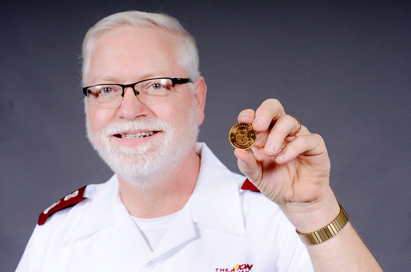 Don Knight | The Herald Bulletin<br /> Salvation Army Major Mike Wolfe holds a gold Krugerrand donated to the local Red Kettle campaign. The coin was placed in the Red Kettle at Hobby Lobby.