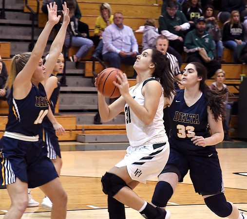 John P. Cleary | The Herald Bulletin<br /> Pendleton's Aubree Dwiggins drives the lane from the top of the key for a basket.