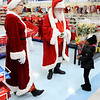 Don Knight | The Herald Bulletin<br /> Arielle Campbell, 4, meets Santa and Mrs. Claus during FOP's  Cops & Kids Program at Meijer on Tuesday.