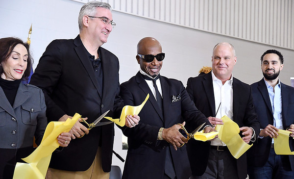 John P. Cleary | The Herald Bulletin<br /> Beverly Parenti, executive director The Last Mile; Indiana Governor Eric Holcomb; MC Hammer, The Last Mile board member; Rob Carter, commissioner Indiana Department of Corrections; and Justin Steele of Google.org, save a piece of ribbon after celebrating the announcement of Google.org's $2 million grant to The Last Mile to support the launch of Indiana's first coding program for incarcerated juveniles at the Pendleton Juvenile Correctional Facility.