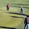 John P. Cleary | The Herald Bulletin<br /> With sunshine, little wind, and temperatures in the upper 40's Grandview Golf Course was a busy place Wednesday afternoon as area golfers took advantage of the conditions to get some post-Christmas swings in like this group putting up to the eighth green.