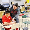 Don Knight | The Herald Bulletin<br /> Alexandria teacher Brian Adams answers a question for Caleb Hartwell.