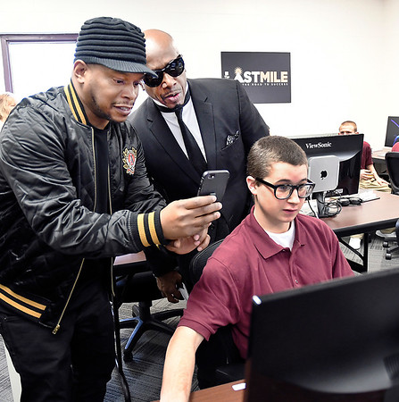 John P. Cleary | The Herald Bulletin<br /> The Last Mile board members, Sway Calloway, producer and retired rapper, and hip hop recording artist MC Hammer, look at Pendleton Juvenile Correctional Facility inmate Jonah Wallsmith's website he's designed in The Last Mile classroom.<br /> Google.org announced a $2 million grant to The Last Mile Tuesday that will help support the launch of Indiana's first coding program for incarcerated juveniles at the Facility.