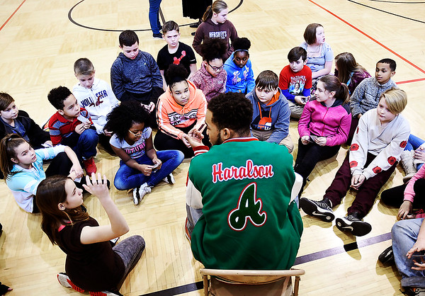 John P. Cleary | The Herald Bulletin<br /> Anderson High School basketball player Brandon Haralson answers a question as he talks to fifth-graders at Tenth Street Elementary School Thursday during an Athletes of Character event at the school.