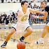 Don Knight | The Herald Bulletin<br /> Lapel's Reid Ratzlaff drives as he is guarded by Burris' Alex Halley as the Bulldogs hosted the Owls on Saturday.