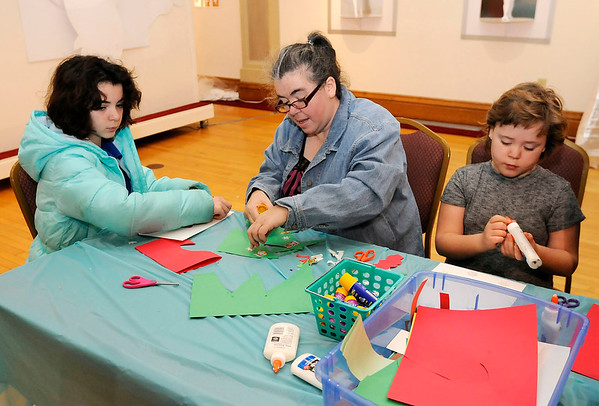 Don Knight | The Herald Bulletin<br /> From left, Abbi, Pam and Hannah Konkle make holiday cards during Family Fun Day at the Anderson Museum of Art on Saturday.
