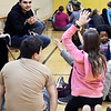 John P. Cleary | The Herald Bulletin<br /> Anderson High School track athlete Eduardo Gomez picks out a fifth-grade student at Tenth Street Elementary School Thursday to give her answer to his question during an Athletes of Character event at the school.