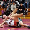Don Knight | The Herald Bulletin<br /> Pendleton Heights' Tremor Bynum gets Alexandria's Daniel Snyder in a cradle in the 195 pound bout as the Tigers hosted the Arabians on Wednesday.