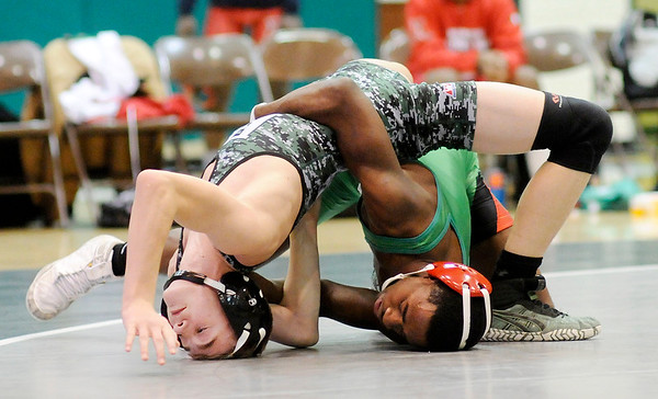 Don Knight | The Herald Bulletin<br /> Anderson's Willie Dennison wrestles Pendleton Heights' Jaiden Tong in the 120-pound match as the Arabians hosted the Indians on Thursday.