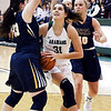 John P. Cleary | The Herald Bulletin<br /> Pendleton's Aubree Dwiggins splits Delta defenders as she drives to the basket for a shot.