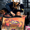 John P. Cleary | The Herald Bulletin<br /> Anderson Elementary kindergartener Ra'Monte Brown is all smiles as Pacemate Brooke helps him carry his new toy he received from the Jakks Pacific - Pacers toy giveaway held at the school Thursday.