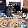 John P. Cleary | The Herald Bulletin<br /> Volunteers deliver turkeys to Operation Love Ministries Friday afternoon. Red Hot Motors and PNC Bank bought 200 turkeys to be distributed to area shelters and food pantries for the holidays. Pictured are Karl Lazar, of Grace House, handing off a box to Skip Ockomon of Anderson Fire Department, as Andrea Baker, executive director of Operation Love, grabs another box of turkeys to help unload.