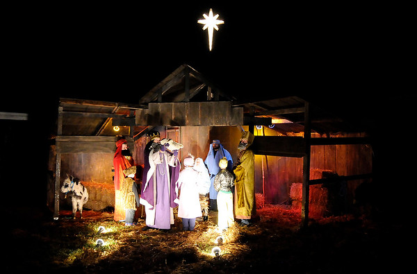 Don Knight | The Herald Bulletin<br /> The three wise men follow the star to Jesus in the Live Nativity at Maple Grove Church of God on Saturday.