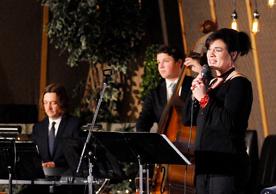 Don Knight   The Herald Bulletin Lana Ranahan performs with father and son musicians Russ and Trey Campbell during the Christmas Tea at Gaither Studios on Saturday.