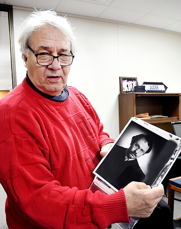 John P. Cleary   The Herald Bulletin<br /> Judge Tom Newman shows a photograph of himself that he used in his first campaign for judge from 1976.