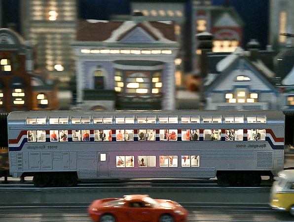 John P. Cleary | The Herald Bulletin<br /> Commuters enjoy the lounge car as they speed through the city on Larry Davenport's train display at the Paramount Theatre.