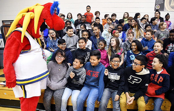 John P. Cleary | The Herald Bulletin Freddy Fever gets the attention of Anderson elementary School students during the Jakks Pacific - Pacers toy giveaway program Thursday.