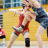 Don Knight | The Herald Bulletin<br /> Pendleton Heights' Jacob Fiew gets his leg free from the grip of Anderson's BradLee Thomas in the 138-pound match on Thursday.