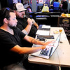 Don Knight | The Herald Bulletin<br /> From left, Justin Alley and Kyle Buck go over the halftime scores during Top Live Trivia at Kettle Top Brewhouse on Tuesday.