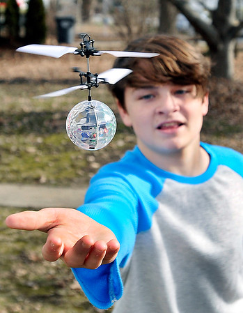 John P. Cleary   The Herald Bulletin<br /> Kaed Abshire, 13, learns how to control his new Christmas gift, an Induction Crystal Ball, Tuesday afternoon as he plays outside his home on Monroe Street in Alexandria.