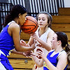 John P. Cleary | The Herald Bulletin<br /> Muncie Burris players Jasie Johnson and Jenna Lis with Liberty Christian's Irelynd Evans try to get a handle on this loose ball as Johnson gets a face-full of ball.