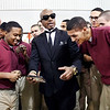 John P. Cleary | The Herald Bulletin<br /> Hip hop recording artist MC Hammer is surrounded by students of The Last Mile program at the Pendleton Juvenile Correctional Facility Tuesday as he shows them a group photo of themselves he had taken on his smart phone. Hammer is a board member of The Last Mile and was at the facility for the Google.org announcement of a $2 million grant to The Last Mile to support the launch of Indiana's first coding program for incarcerated juveniles at the Pendleton Juvenile Correctional Facility.<br /> <br /> <br /> Google.org announced a $2 million grant to The Last Mile to support the launch of Indiana's first coding program for incarcerated juveniles at the Pendleton Juvenile Correctional Facility.