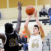 Don Knight | The Herald Bulletin<br /> Lapel's Cole Alexander shoots as he is guarded by Burris' James Roysdon as the Bulldogs hosted the Owls on Saturday.
