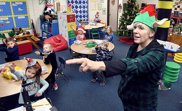 John P. Cleary   The Herald Bulletin<br /> Liberty Christian kindergarten teacher Tammy Ramsey leads her students in writing out letters with their arms to help them better visualize their shape before writing them down on paper. The school is using a new reading program for kindergarten and first-grade students.