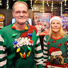 Don Knight | The Herald Bulletin<br /> Ronnie Jordan and Mary Smith donned sweaters for the Ugly Christmas Sweater contest and silent auction at Moran's Bar and Grill on Saturday.