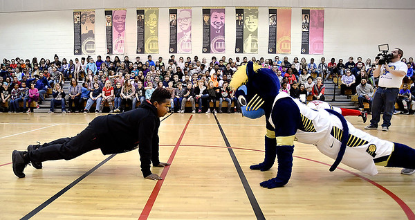 John P. Cleary | The Herald Bulletin Anderson elementary School fifth-grader Breon Wilson, 12, matches pushups with Boomer the Pacers mascot in front of the student body during the Jakks Pacific - Pacers toy giveaway program Thursday.
