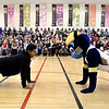 John P. Cleary | The Herald Bulletin<br /> Anderson elementary School fifth-grader Breon Wilson, 12, matches pushups with Boomer the Pacers mascot in front of the student body during the Jakks Pacific - Pacers toy giveaway program Thursday.
