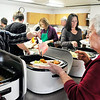 John P. Cleary | The Herald Bulletin<br /> Volunteer Stephanie Hilton serves up some ham for Neoma Sills Tuesday during the annual St. Mary's Catholic Church Christmas day dinner in Alexandria.