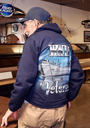 John P. Cleary | The Herald Bulletin<br /> 98 year-old WWII Navy veteran Gene Smith shows off his ship that he had airbrushed on the back of his sweatshirt.