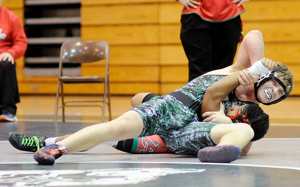 Don Knight | The Herald Bulletin<br /> Pendleton Heights' Jesse Johns pins Anderson's Isreal Dates in the 170-pound match on Thursday.
