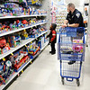 Don Knight | The Herald Bulletin<br /> Markleville Police Officer Jacob Reed shops with AC Stephens during the FOP's  Cops & Kids Program at Meijer on Tuesday.