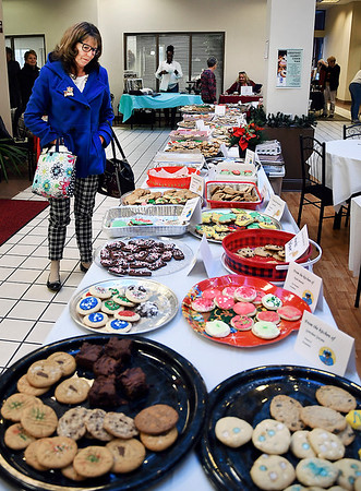 John P. Cleary   The Herald Bulletin<br /> Soroptimist International of Anderson had their annual Holiday Celebrity Cookie Walk as part of Anderson downtown Winterfest celebration Friday at the Union Building lobby where hundreds of cookies were for sale to help provide Educational Awards to women and girls.