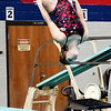 John P. Cleary | The Herald Bulletin<br /> Elwood's Annaka Wilson performs one of her dives she did during the swimming meet against Liberty Christian Monday evening.