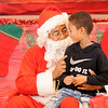 Don Knight | The Herald Bulletin<br /> London Kayzer, 8, talks to santa after getting his picture taken during the City Wide Toy Giveaway at the UAW on Saturday.