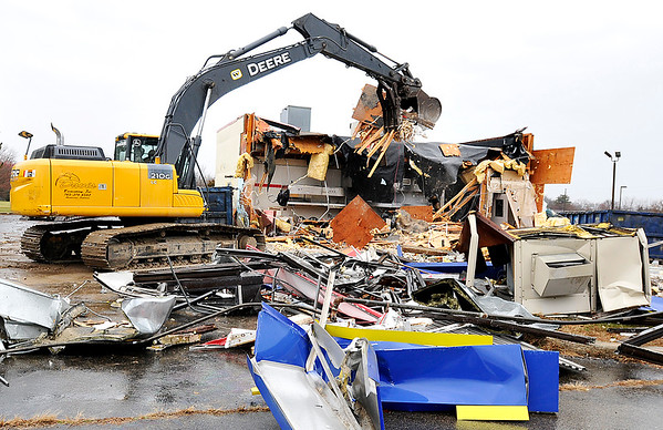 John P. Cleary | The Herald Bulletin<br /> Davis Excavating started tearing down the old Popeyes Chicken building in the 300 block of South Scatterfield Thursday. The building has sat vacant for many years.